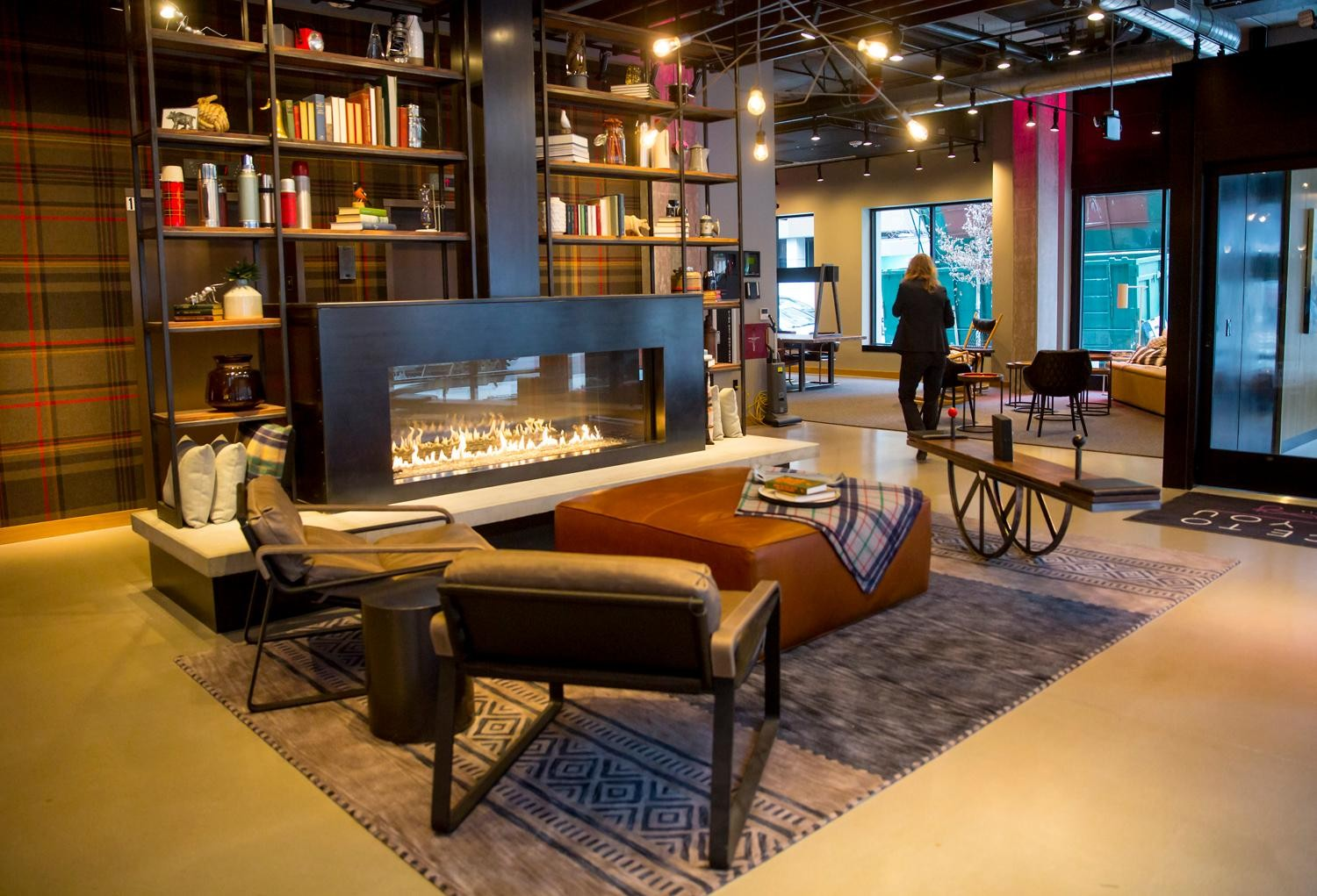 "Welcome to Moxy Seattle Downtown: Marriott's new experiential line that opened up Wednesday, Feb. 21, 2018, in South Lake Union (1016 Republican St). They only one of its kind on the West Coast, Moxy caters to the energetic city goer with an ""always-on"" vibe, sporting a teeter totter in the lobby, weekly trivia game nights, a bar that doubles as the reception desk, and a complimentary ""Got Moxy"" cocktail when you walk through the door. There are 146 rooms spread over eight floors, designed with smaller square footage per room (195 to 205 square-feet) but keeping all the accommodations in the right place. The lobby/bar is the heartbeat of the hotel and emphasizes 24/7 socializing- so party on at the Moxy! (Sy Bean / Seattle Refined)"